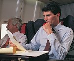 Reading confidential docs on plane raises workplace issues