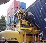 Port worker injured by falling container